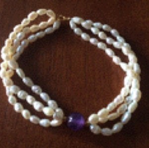 Multi Strand Fresh Water Pearl And Amethyt Ball Set In 14kt Yelow Gold 8 Inches Long