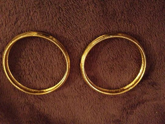 Chanel Two Vintage Chanel Gold-Plated Bangles