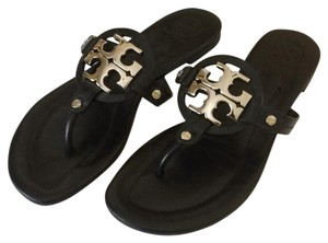 Tory Burch Black leather with silver colored metal accent Sandals