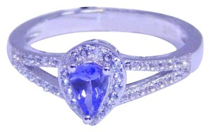 Tanzanite GENUINE PEAR SHAPE STARBURST CUT TANZANITE RING 0.55 CTS. WHITE TOPAZ IN STERLING SILVER