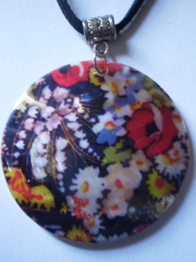 Handmade flowers on mother of pearl necklace