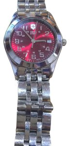 Victorinox WOMENS VICTORINOX SWISS ARMY WATCH WITH RED FACE.