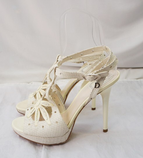 Preload https://item1.tradesy.com/images/dior-ivory-christian-floral-reptile-embossed-leather-heeled-sandals-size-us-95-regular-m-b-1689220-0-0.jpg?width=440&height=440