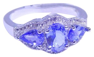 TANZANITE APPEALING OVAL TANZANITE RING OVAL AND PEAR THREE-STONE SETTING STERLING SILVER