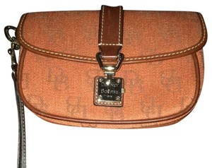 Dooney & Bourke Orange Rust Burnt Orange Wristlet in Orange/Rust