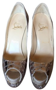 Christian Louboutin Sliver mirrored with a beige satin toe Platforms