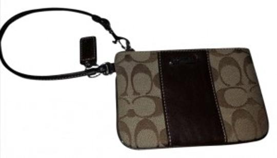 Preload https://item2.tradesy.com/images/coach-with-trim-brown-sateen-and-leather-wristlet-169091-0-0.jpg?width=440&height=440