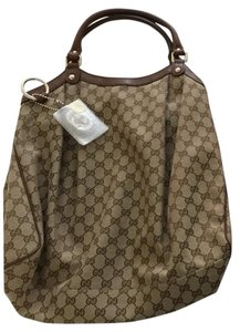 Gucci Monogrammed Canvas Bucket Style Tote Tote in Tan