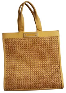 7fdb21940c1c Yellow Tory Burch Bags - Up to 90% off at Tradesy