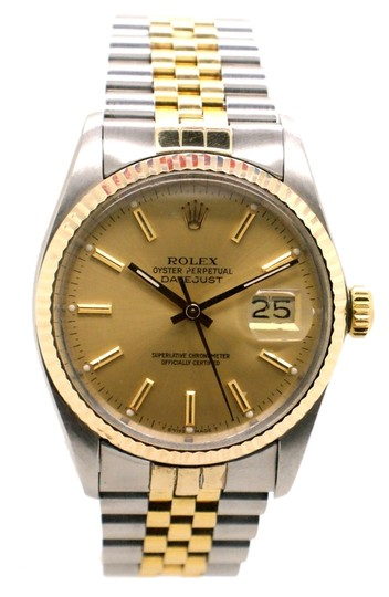 Preload https://item2.tradesy.com/images/rolex-stainless-steel-men-s-16013-and-18k-gold-datejust-men-s-watch-1693536-0-0.jpg?width=440&height=440