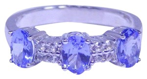 TANZANITE ELEGANT OVAL SHAPE TANZANITE RING WHITE TOPAZ STONES IN THREE-STONE SETTING STERLING SILVER