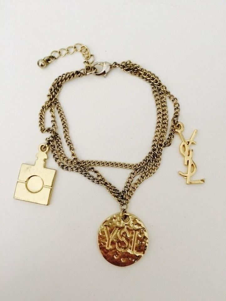 b637ee2149f Saint Laurent YVES SAINT LAURENT YSL CHARM PERFUME LOGO BRACELET GOLD  COLOUR Image 0