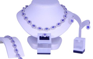 Elegant Oval shape Tanzanite Necklace Set , Ring, Earring Bracelet White Topaz Stones Around Main Stone in Halo Setting Sterling Silver