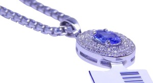 APPEALING OVAL SHAPE TANZANITE PENDANT WHITE TOPAZ STONES AROUND MAIN STONE IN HALO EARRING SETTING STERLING SILVER