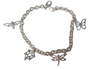 Tiffany & Co. Tiffany & Co sterling silver nature charms bracelet, 7.25