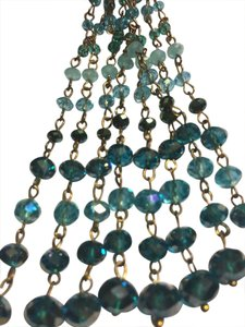 Other Gorgeous baby blue Rhine stones necklace, gold and suede chain