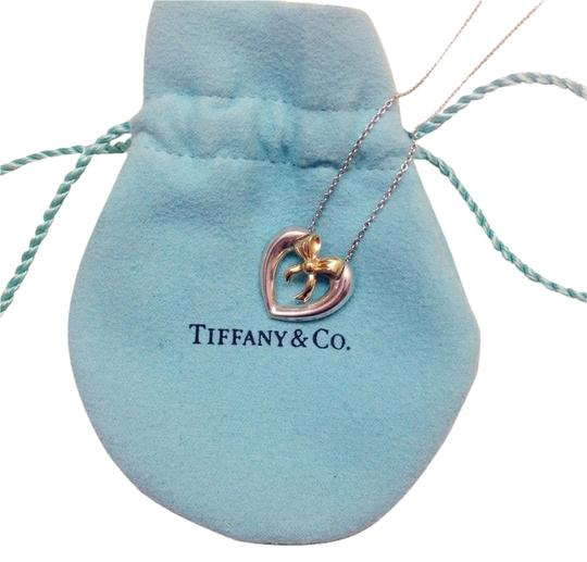 Preload https://item4.tradesy.com/images/tiffany-and-co-co-18k-gold-hearibbon-necklace-in-16-inch-chain-1696908-0-0.jpg?width=440&height=440