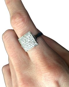 SZ 7 Sterling Silver and CZ Ring. Stamped with .925. This ring is stunning with CZ and rhodium plated .925 sterling silver. It looks like white gold. Sparkle and shine all the time!