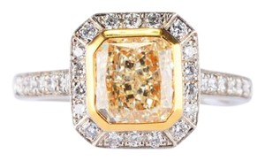 Fancy Light Yellow Radiant Cut Diamond with Halo Diamonds