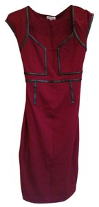 A Pea In The Pod Maroon dress wth faux leather detailing