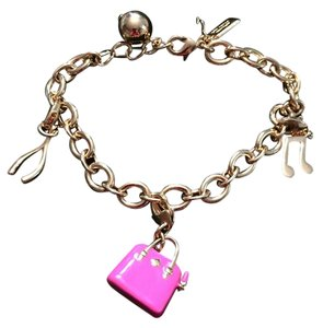Kate Spade Kate Spade Charm Link Bracelet with 3 Charms. Never worn. 7in. long with 1 inch extender.