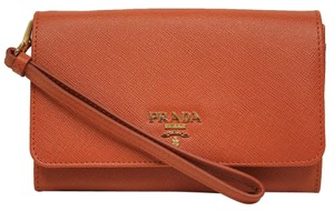 Prada Saffiano Textured Leather Wristlet in orange