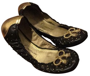 Juicy Couture Black with gold studs Flats