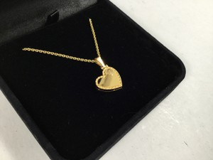 Louis Vuitton Pretty Louis Vuitton 18k Gold Heart Locket Necklace Couer
