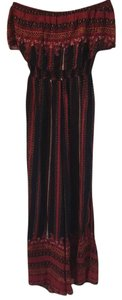 Free People Festival Bohemian Super Flare Pants Black, brick red and rust.