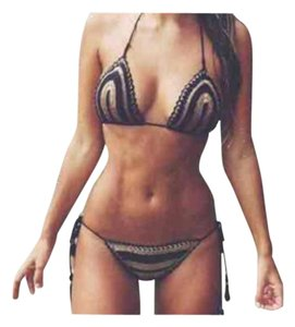 New black & cream striped knit crochet string bikini fits size small to medium. Bottoms pretty cheeky ;-)