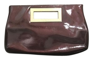 Michael Kors burgundy /gold hardware Clutch