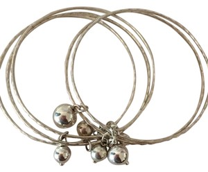 Silver-tone bangles with floating balls