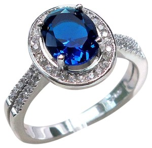 9.2.5 stunning blue and white sapphire round cocktail ring size 6
