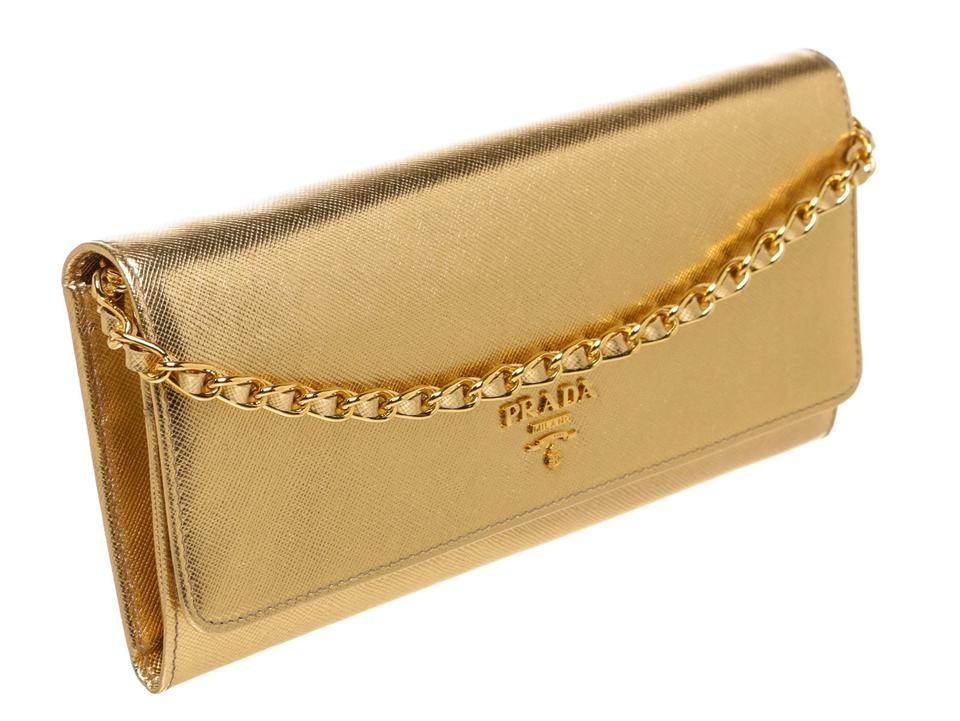 gold prada clutch