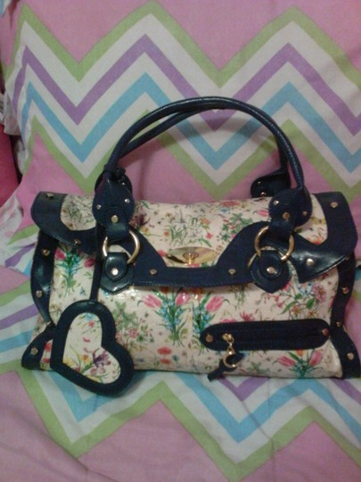 Preload https://item2.tradesy.com/images/patent-leather-flower-print-with-navy-blue-patent-leather-trim-shoulder-bag-1708186-0-0.jpg?width=440&height=440