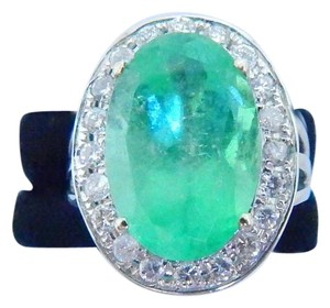 STUNNING OVAL SHAPE MM STARBURST CUT EMERALD RING 9.7 CARATS. 1.0 CARATS TOTAL DIAMOND IN SHANK/SPLIT-SHANK 14KT WHITE GOLD
