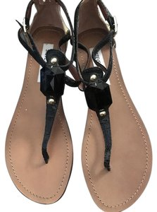 Steve Madden Black and gold with a black stone. Sandals