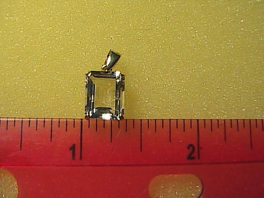 Unknown 3.6 cts 10k solid Yellow Gold White Topaz Pendant