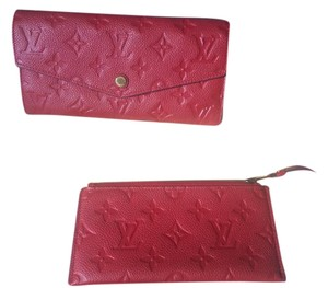 Louis Vuitton 2013 Louis Vuitton Empreinte CURIEUSE. red wallet