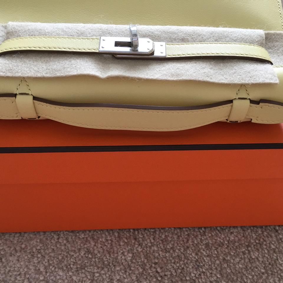 hermes kelly mini pochette in tangerine ostrich with gold hardware