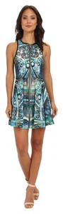 Romeo & Juliet Couture short dress Abstract Pattern Sleeveless Front Zip Abstract on Tradesy
