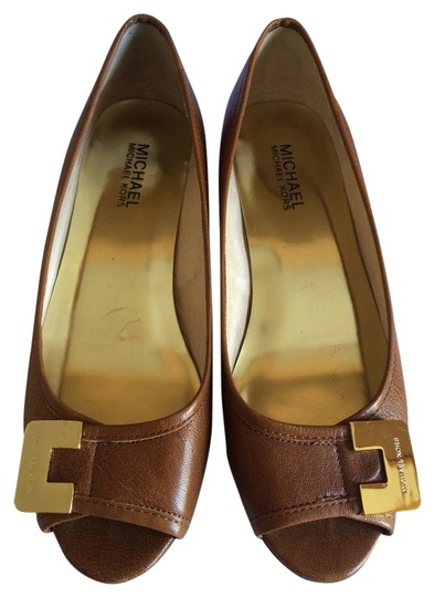 Preload https://item4.tradesy.com/images/michael-kors-tobacco-beverly-demi-wedges-size-us-7-regular-m-b-1712238-0-0.jpg?width=440&height=440
