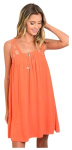 LoveRiche short dress orange on Tradesy