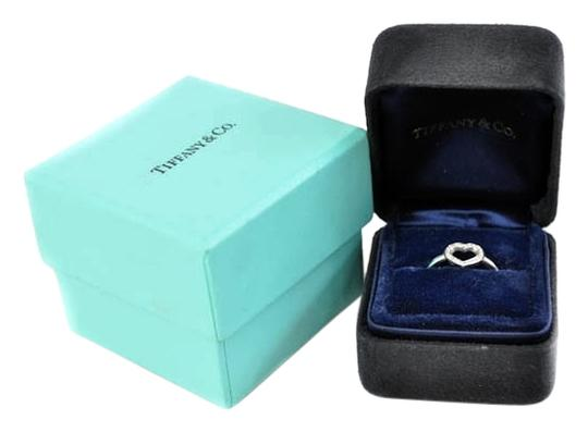 Preload https://item1.tradesy.com/images/tiffany-and-co-platinum-open-heart-diamond-size-4-ring-1713795-0-0.jpg?width=440&height=440