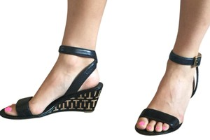 Tory Burch Black and tan Wedges