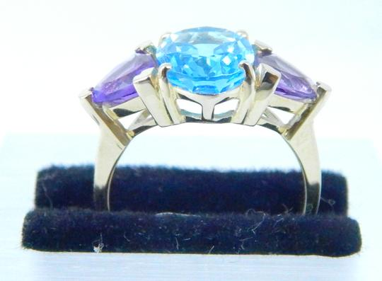 Other STUNNING OVAL SHAPE STARBURST CUT BLUE TOPAZ RING 3.5 CT. 2 CT AMETHYST IN THREE-STONE SETTING 14KT GOLD Image 3
