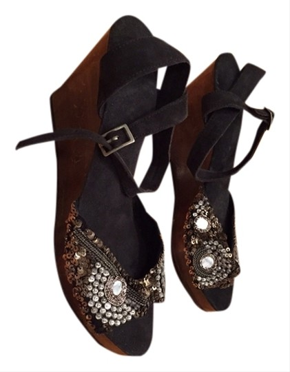 Preload https://item2.tradesy.com/images/black-wooden-sequence-sandals-size-us-95-narrow-aa-n-1714346-0-0.jpg?width=440&height=440