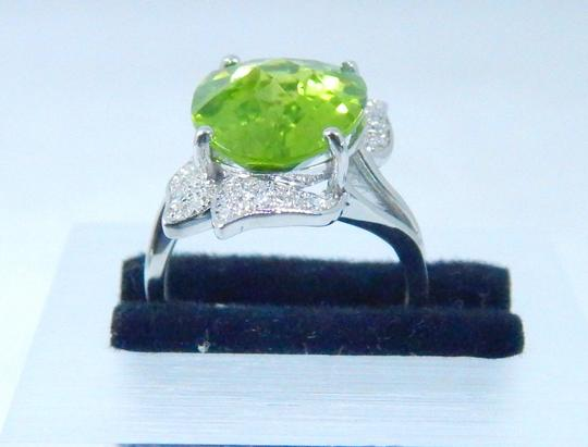 Other APPEALING OVAL SHAPE STARBURST CUT PERIDOT RING 7.5 CT. 0.5 (TOTAL)DIAMOND IN SHANK/SPLIT-SHANK 14KT WHITE GOLD Image 2