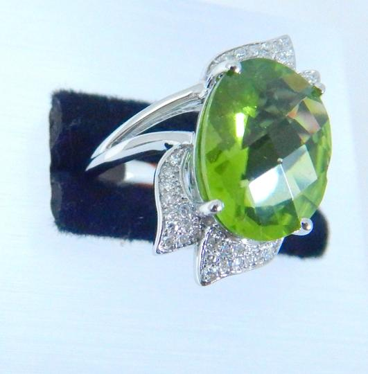 Other APPEALING OVAL SHAPE STARBURST CUT PERIDOT RING 7.5 CT. 0.5 (TOTAL)DIAMOND IN SHANK/SPLIT-SHANK 14KT WHITE GOLD Image 3