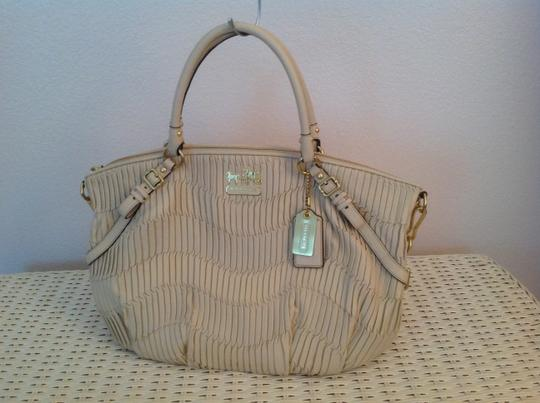 Preload https://item4.tradesy.com/images/coach-limited-edition-2010-15947-madison-sophia-collection-bone-italian-leather-satchel-1714493-0-0.jpg?width=440&height=440